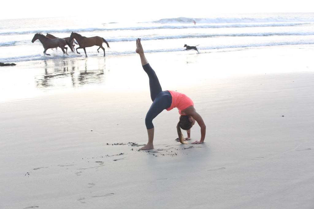Alana Roach experiencing FREEDOM! Wild Horses on in Santa Teresa, Costa Rica with lancelaurence.com